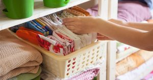 Hand-Organizing-Sheets-KonMari Method-Decluttering and Storage-BoxNCo-June-2019